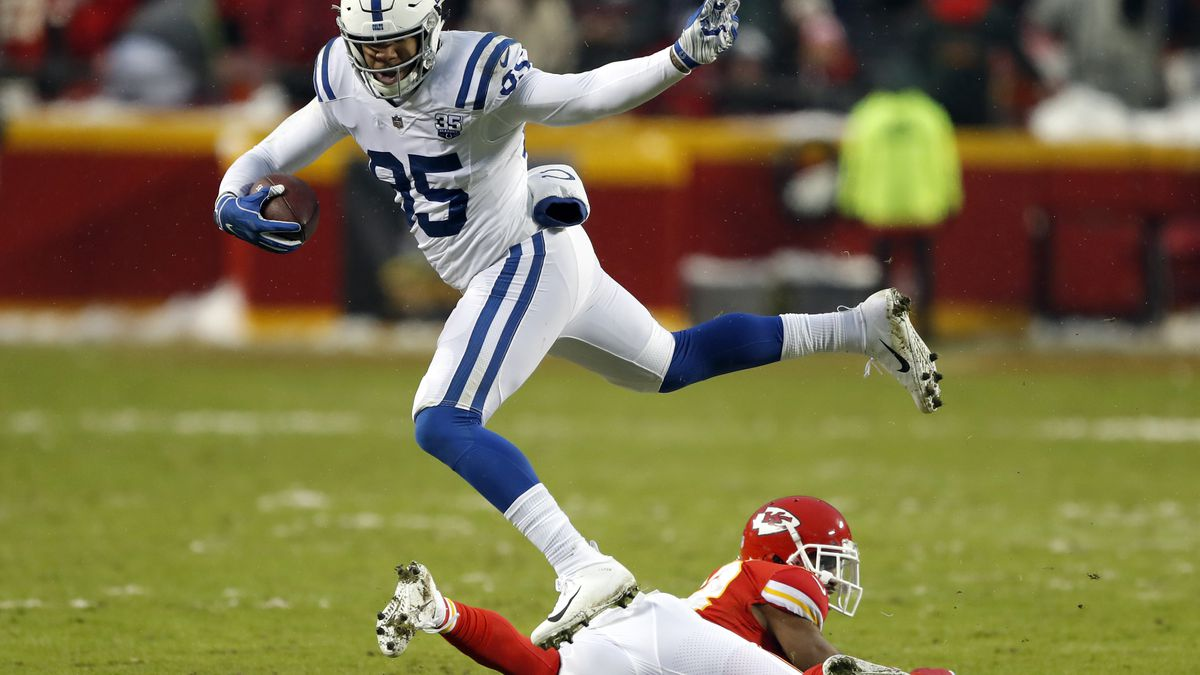 Indianapolis Colts tight end Eric Ebron (85) vaults Kansas City Chiefs cornerback Kendall Fuller (23) during the first half of an NFL divisional football playoff game in Kansas City, Mo., Saturday, Jan. 12, 2019. (AP Photo/Charlie Neibergall)