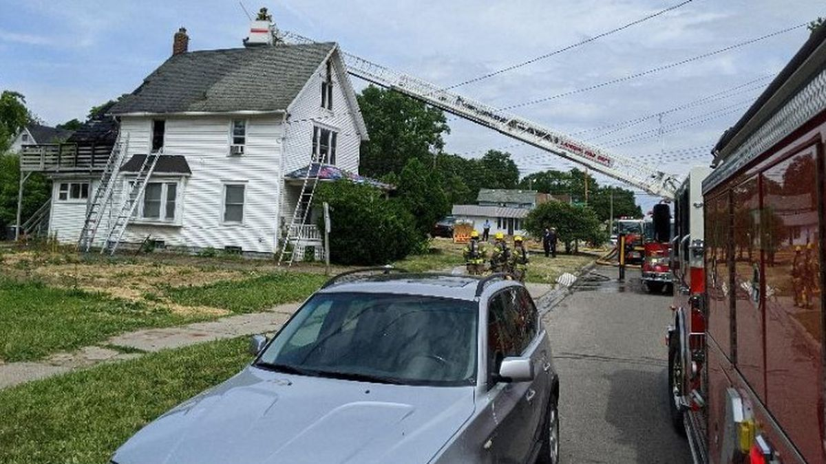 A fire damaged a multi-unit home Friday near Lansing's Old Town neighborhood. (Source: WILX)