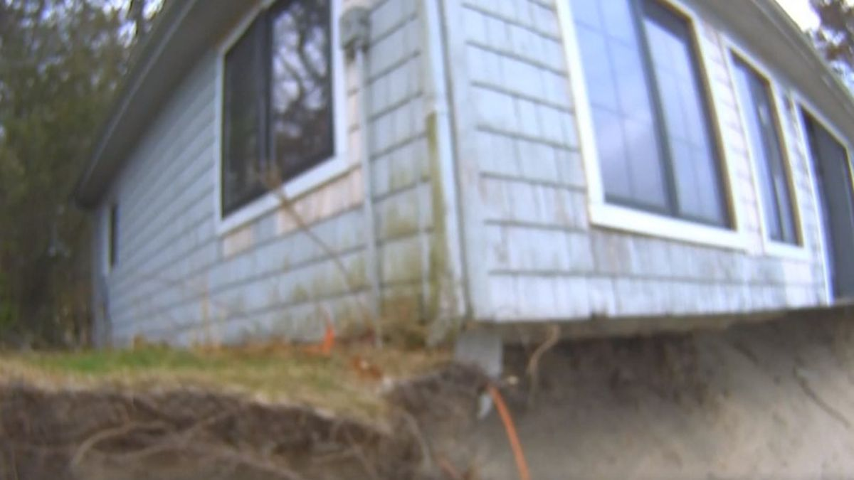 A house that's dangling over Lake Michigan, won't be allowed to fall into the lake. (Source: WILX)