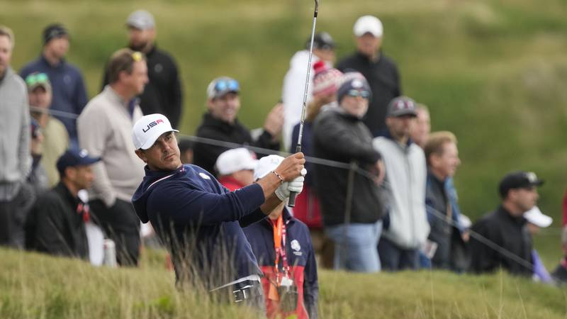 Team USA's Brooks Koepka hits on the fifth hole during a practice day at the Ryder Cup at the...