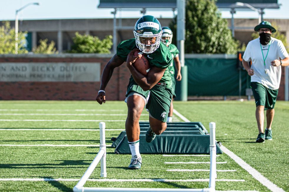 Elijah Collins practicing with Michigan State Football