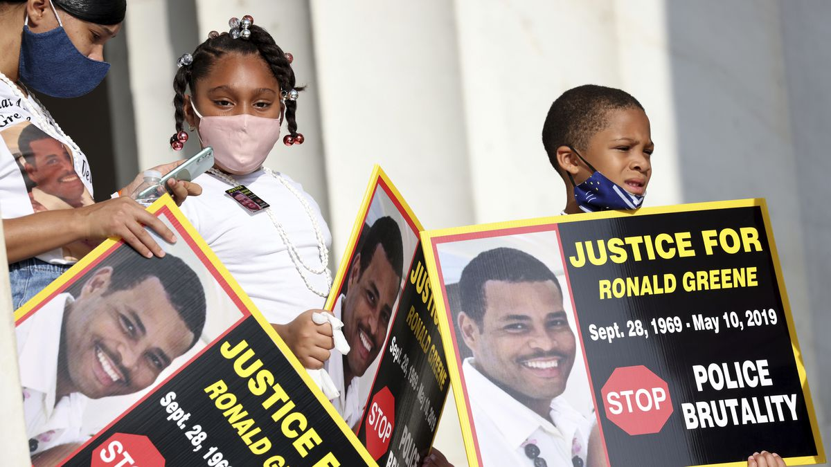"""FILE - In this Aug. 28, 2020 file photo, family members of Ronald Greene listen to speakers as demonstrators gather for the March on Washington, in Washington, on the 57th anniversary of the Rev. Martin Luther King Jr.'s """"I Have A Dream"""" speech. Officials told The Associated Press, federal authorities are investigating the death of Greene during what Louisiana State Police described as a struggle to take him into custody following a rural police chase last year. The death of the 49-year-old remains shrouded in secrecy because State Police have declined to release body-camera footage related to the May 2019 chase north of Monroe, La."""