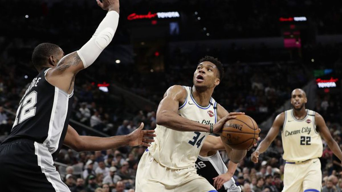 Milwaukee Bucks forward Giannis Antetokounmpo (34) looks to shoot over San Antonio Spurs center LaMarcus Aldridge (12) during the second half of an NBA basketball game, in San Antonio, Monday, Jan. 6, 2020. (AP Photo/Eric Gay)