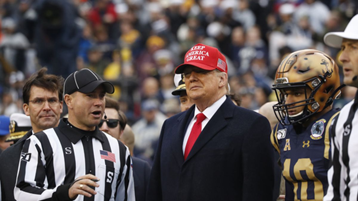 President Donald Trump waits for the coin toss before the start of the Army-Navy college football game in Philadelphia, Saturday, Dec. 14, 2019. (AP Photo/Jacquelyn Martin)
