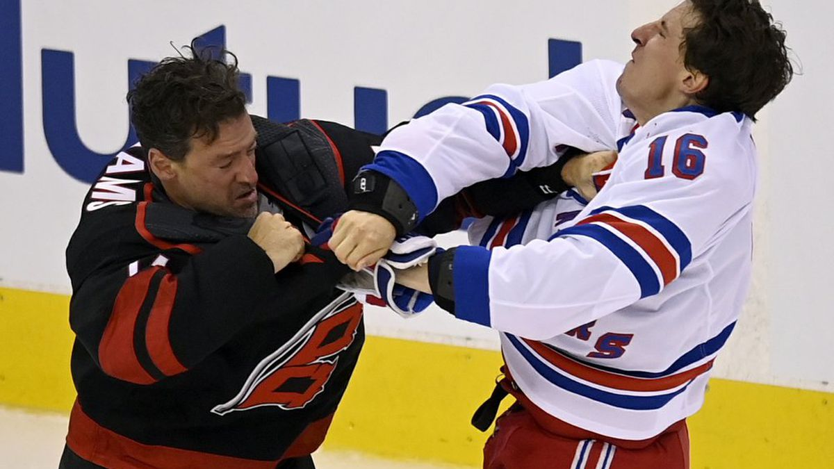 New York Rangers' Ryan Strome (16) fights with Carolina Hurricanes' Justin Williams during the...