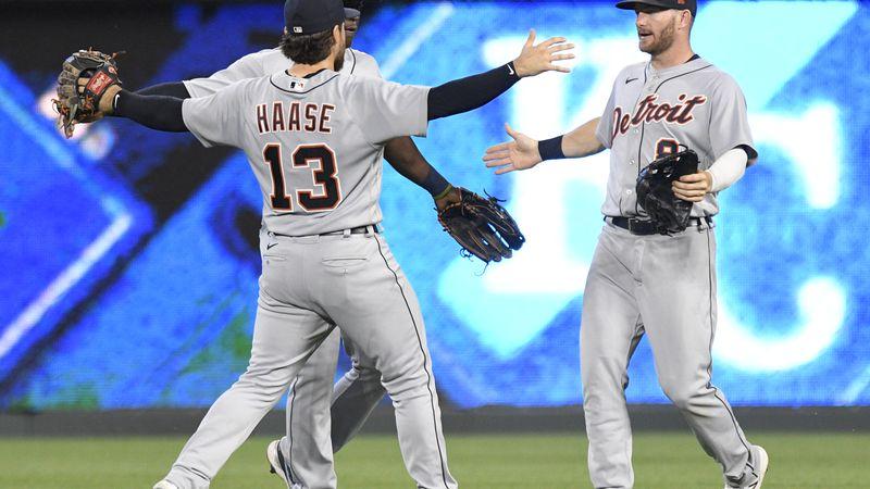 Detroit Tigers' Eric Haase (13), Daz Cameron, rear, and Robbie Grossman (8) celebrate the...
