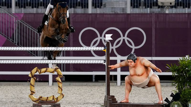 Britain's Harry Charles, riding Romeo 88, competes during the equestrian jumping individual...