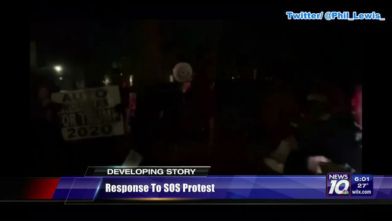 Michigan Secretary of State Jocelyn Benson says armed protesters were outside her house...