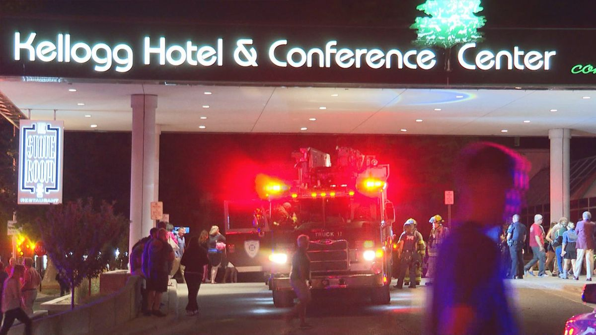 People gather outside the Kellogg Hotel & Conference Center on Thursday, Aug. 15. (Source: WILX).
