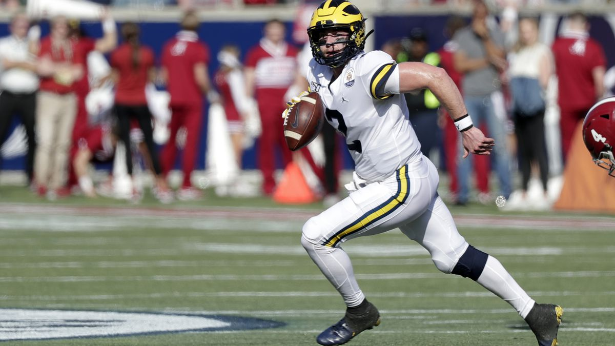 Michigan quarterback Shea Patterson (2) scrambles during the first half of the Citrus Bowl NCAA college football game against Alabama, Wednesday, Jan. 1, 2020, in Orlando, Fla. (AP Photo/John Raoux)