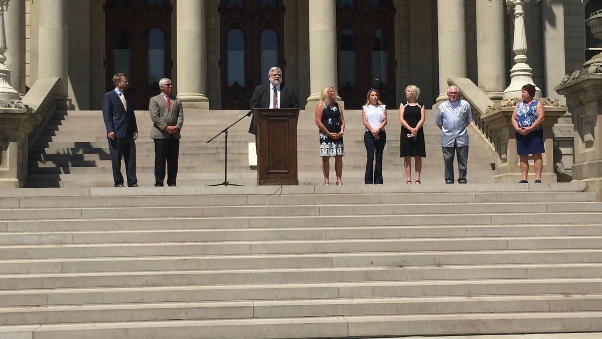Lawyers representing hairstylists across the state held a news conference at the State Capitol Monday. (Source: WILX)