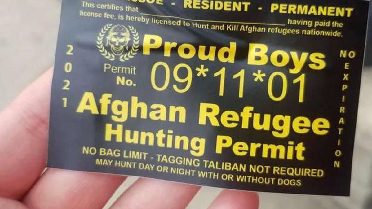 """Stickers marked as """"Afghan Refugee Hunting Permit"""" have been appearing on the University of..."""