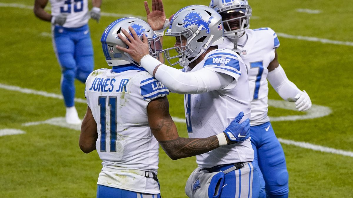 Detroit Lions wide receiver Marvin Jones (11) celebrates a touchdown catch with Detroit Lions...