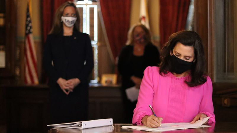 Governor Gretchen Whitmer signed a bill into law allowing clerks to process absentee ballots...