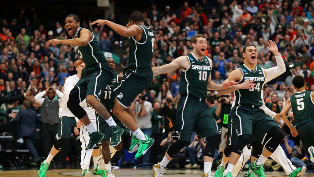 SYRACUSE, NY - MARCH 29:  Alvin Ellis III #3 and Marvin Clark Jr. #0 of the Michigan State Spartans celebrate defeating the Louisville Cardinals 76 to 70 in overtime of the East Regional Final of the 2015 NCAA Men's Basketball Tournament at Carrier Dome on March 29, 2015 in Syracuse, New York.  (Photo by Elsa/Getty Images)