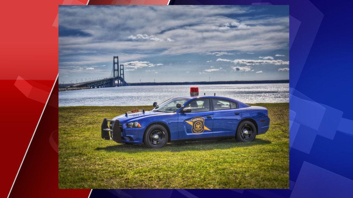 Michigan State Police patrol car parked in front of Mackinac Bridge. (Source: MSP).