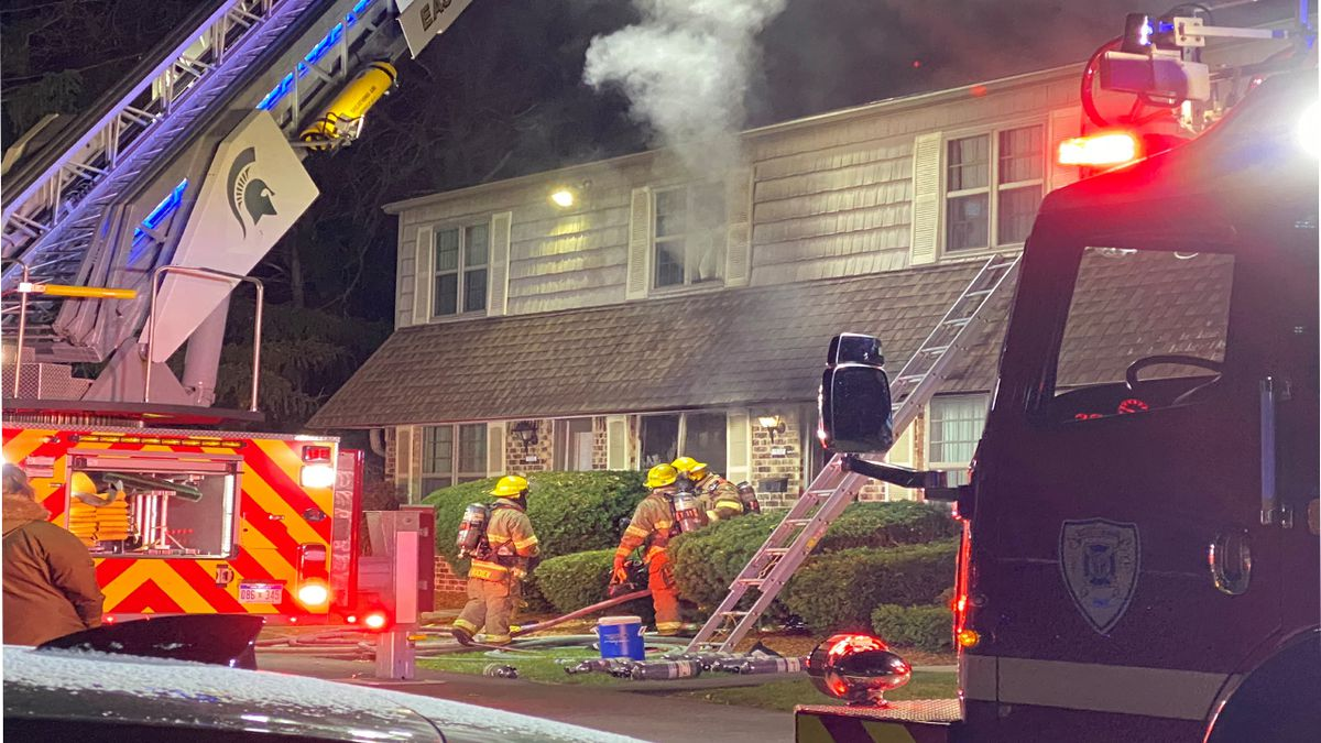 Firefighters respond to fire at Cambria Townhomes in East Lansing on Monday, Nov. 11. (WILX)