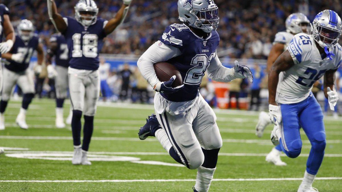 Dallas Cowboys running back Ezekiel Elliott (21) runs into the end zone for a touchdown during...