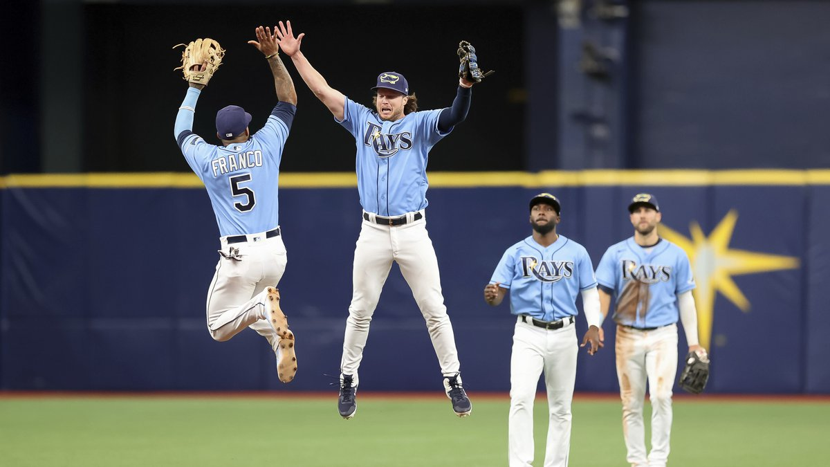 Tampa Bay Rays' Wander Franco (5) and Brett Phillips jump for a high-five as Randy Arozarena...