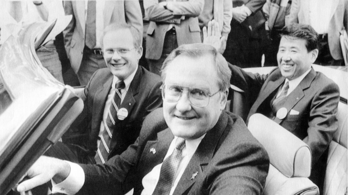 """FILE - In this Oct. 7, 1985 file photo, Illinois Gov. James R. Thompson, behind the wheel of a Chrysler convertible, is joined by G. Glenn Gardner, left, and Yoichi Nakane, after a news conference in Chicago.   Thompson, known as """"Big Jim"""" during a long career that eventually made him the state's longest-serving chief executive, has died. He was 84. Thompson died  Friday, Aug. 14, 2020 at the Shirley Ryan AbilityLab in Chicago, his wife, Jayne, told the Chicago Tribune and the Chicago Sun-Times."""
