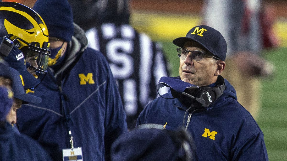 Michigan coach Jim Harbaugh stands on the sideline during the first quarter of the team's NCAA...