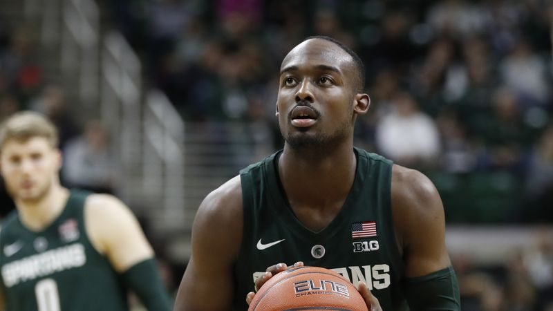 Michigan State guard Joshua Langford shoots a free throw during the second half of an NCAA...