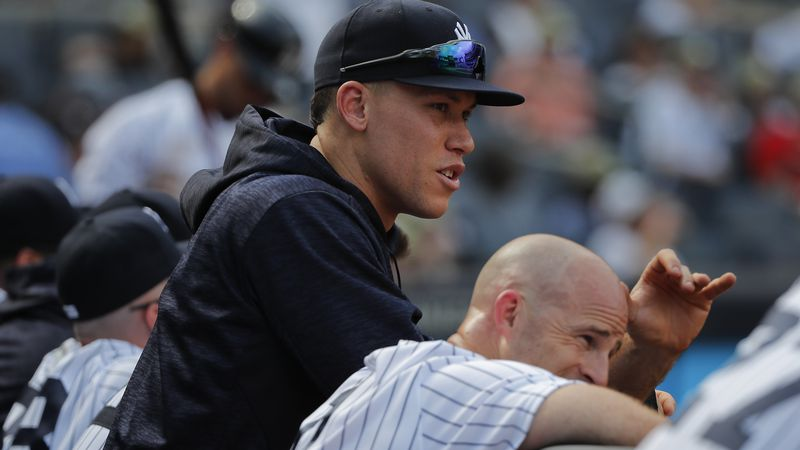 New York Yankees' Aaron Judge, left, and Brett Gardner watch from the dugout during the ninth...
