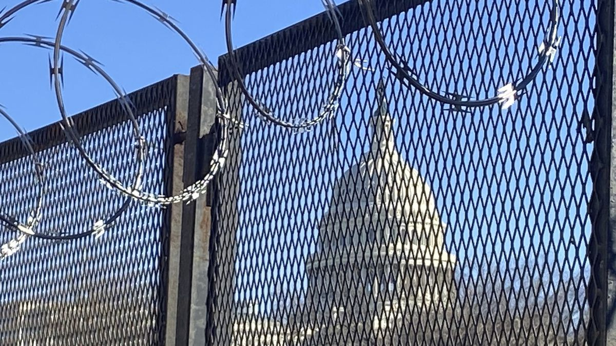 In this Saturday, Jan. 23, 2021 photo, riot fencing, and razor wire reinforce the security zone...