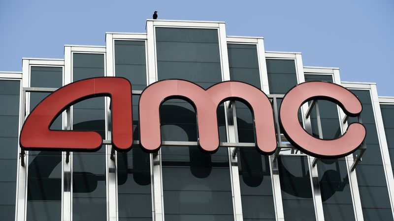 In this April 29, 2020 file photo, the AMC sign appears at the AMC Burbank 16 movie theater...