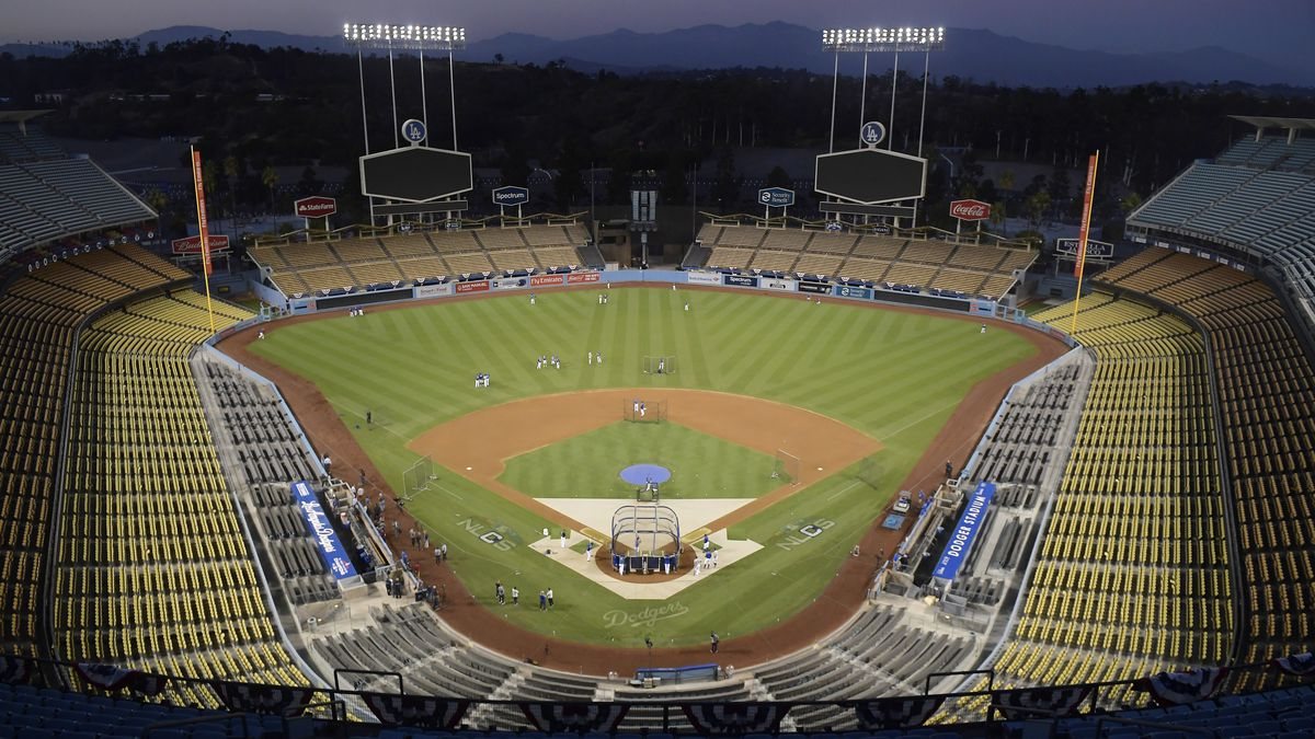 In Oct. 10, 2018, file photo, Dodger Stadium is seen after sunset in Los Angeles. Dodger Stadium will serve as a vote center for the presidential election in November 2020, making the Dodgers the first Major League Baseball team to make their venue available for voting.
