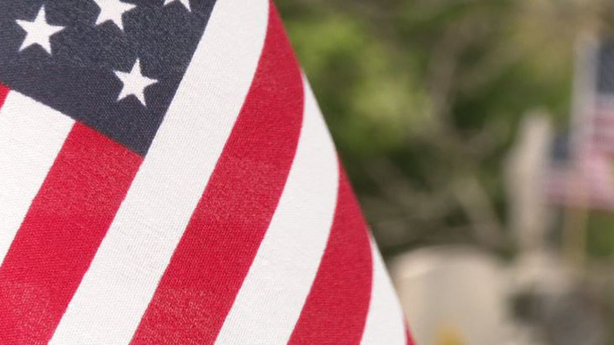 American Flags are placed at veterans' graves for Memorial Day.