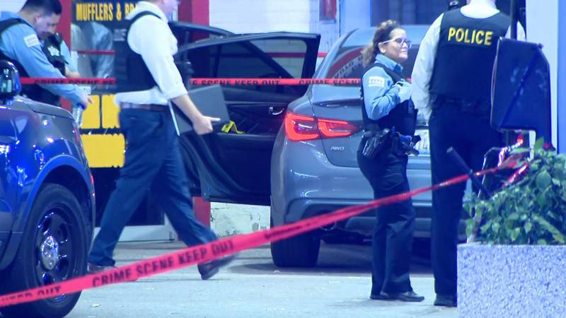 A Chicago police officer's gun accidentally discharged, wounding two other officers.