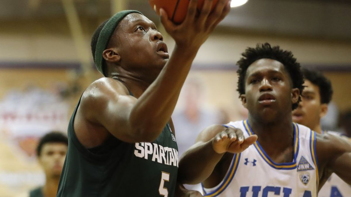 Michigan State guard Cassius Winston (5) heads for the basket ahead of UCLA guard David Singleton (34) during the first half of an NCAA college basketball game Wednesday, Nov. 27, 2019, in Lahaina, Hawaii. (AP Photo/Marco Garcia)