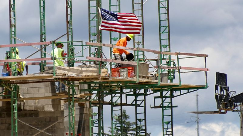 FILE - In this June 11, 2020 file photo, workers on scaffolding lay blocks on one of the larger...