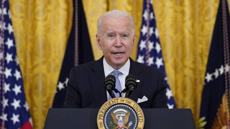 FILE - President Joe Biden speaks from the East Room of the White House in Washington,...