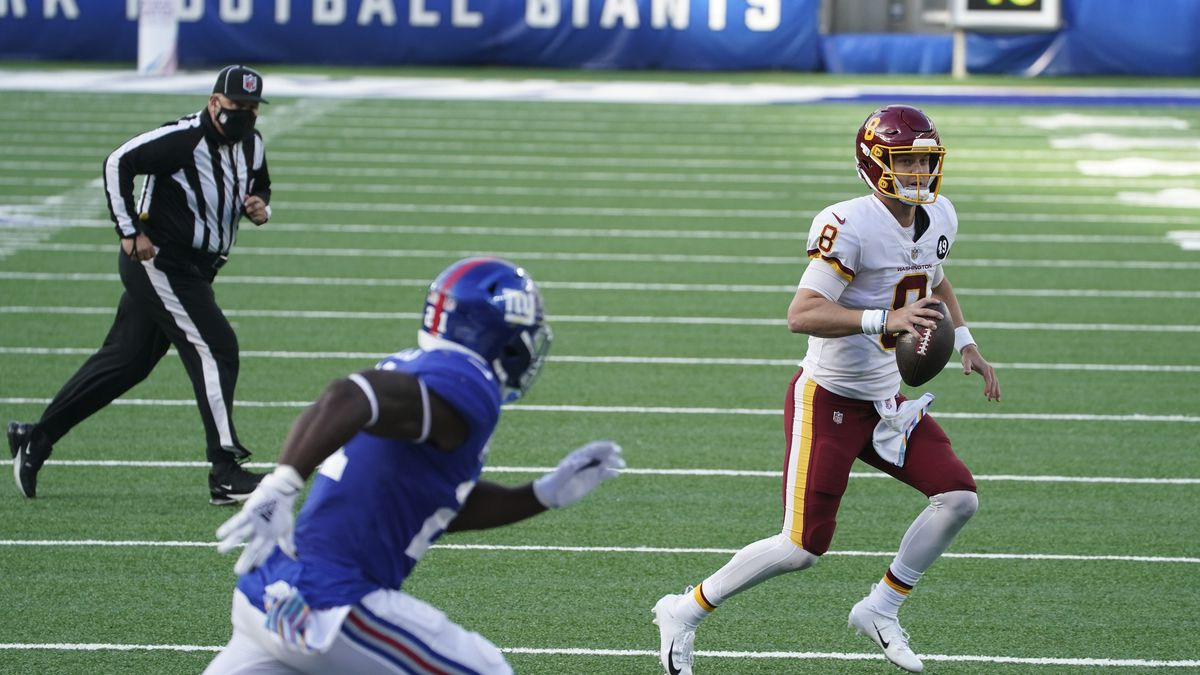 Washington Football Team's Kyle Allen (8) looks to pass on a point after try during the second...