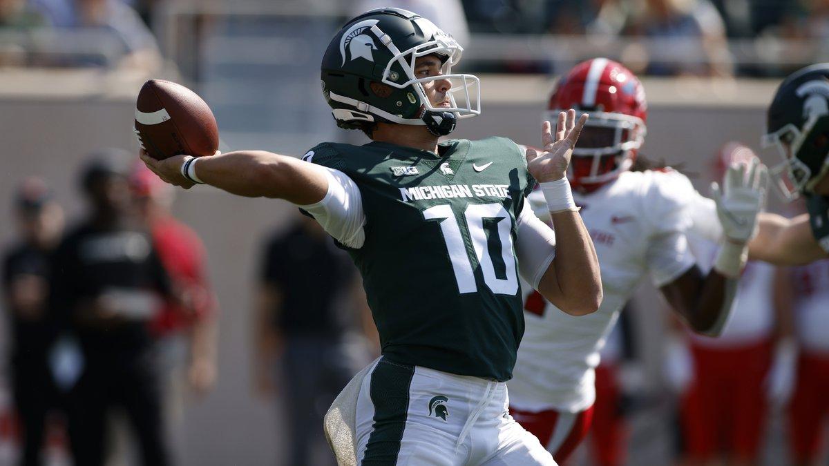 Michigan State quarterback Payton Thorne throws a 75-yard touchdown pass off a flea-flicker on...