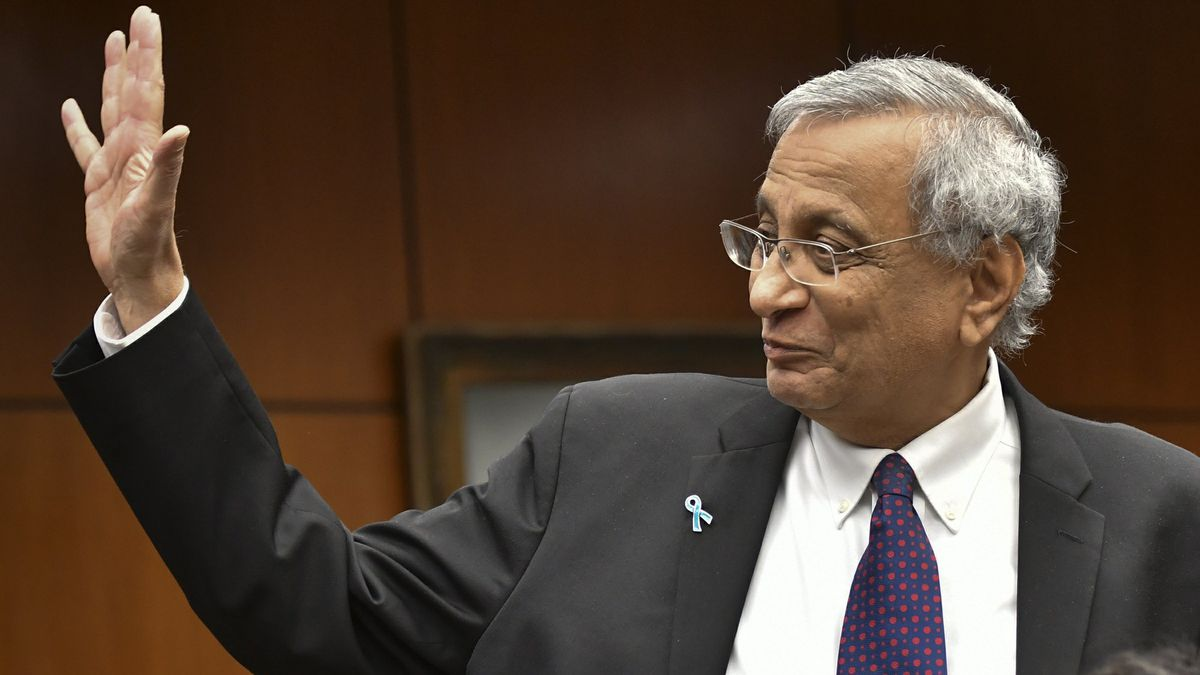 Satish Udpa waves after being named interim president of Michigan State University, Thursday morning, Jan. 17, 2019, during a Board of Trustees meeting at the Hannah Administration Building at MSU in Lansing, Mich. The board acted Thursday, a day after John Engler said he'd step down next week . Engler's resignation comes amid fallout from remarks he made about some victims of former sports doctor and convicted sexual abuser Larry Nassar. (Matthew Dae Smith/Lansing State Journal via AP)