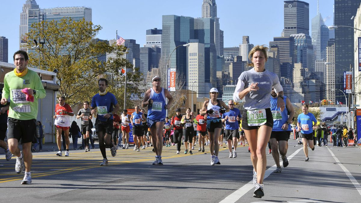 FILE - In this Nov. 3, 2019, file photo, runners take part in the New York City Marathon. The New York City Marathon scheduled for Nov. 1, 2020, has been cancelled because of the coronavirus pandemic. New York Road Runners announced the cancellation of the world's largest marathon Wednesday, June 24, 2020, after coordinating with the mayor's office and deciding the race posed too many health and safety concerns for runners, volunteers, spectators and others. (AP Photo/Eduardo Munoz Alvarez, File)