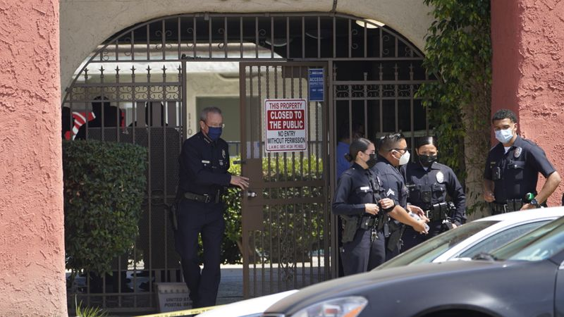 Los Angeles Police Chief Michel Moore exits an apartment complex as police investigate in...