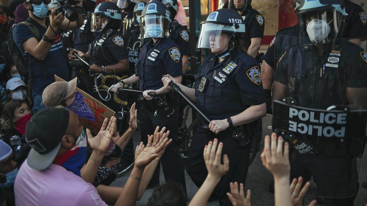 FILE - This May 31, 2020 file photo shows New York City Police facing off with activists during...