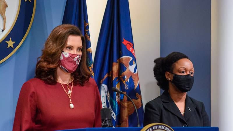 FILE. Michigan Gov. Gretchen Whitmer, left, and MDHHS' Dr. Joneigh Khaldun provide a COVID-19...