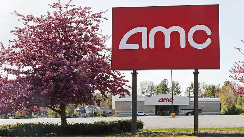 This May 14, 2020, photo shows an AMC theater sign at a nearly empty parking lot for the...