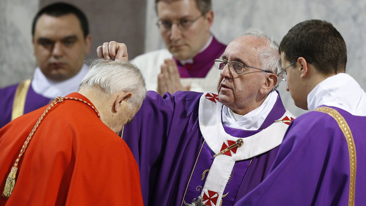 Pope Francis places ashes on head of Slovakian Cardinal Jozef Tomko during Ash Wednesday Mass...