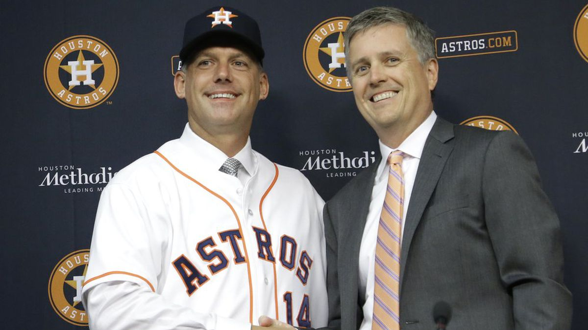 In this Sept. 29, 2014, file photo, Houston Astros general manager Jeff Luhnow, right, and A.J. Hinch pose after Hinch is introduced as the new manager of the baseball club in Houston. Hinch and Luhnow were fired Monday, Jan. 13, 2020, after being suspended for their roles in the team's extensive sign-stealing scheme from 2017.