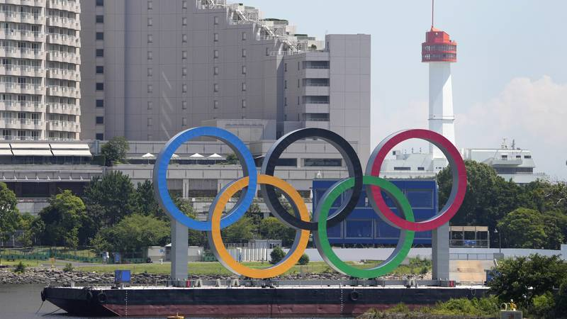 The Olympic rings float on a barge ahead of the 2020 Summer Olympics, Monday, July 19, 2021, in...