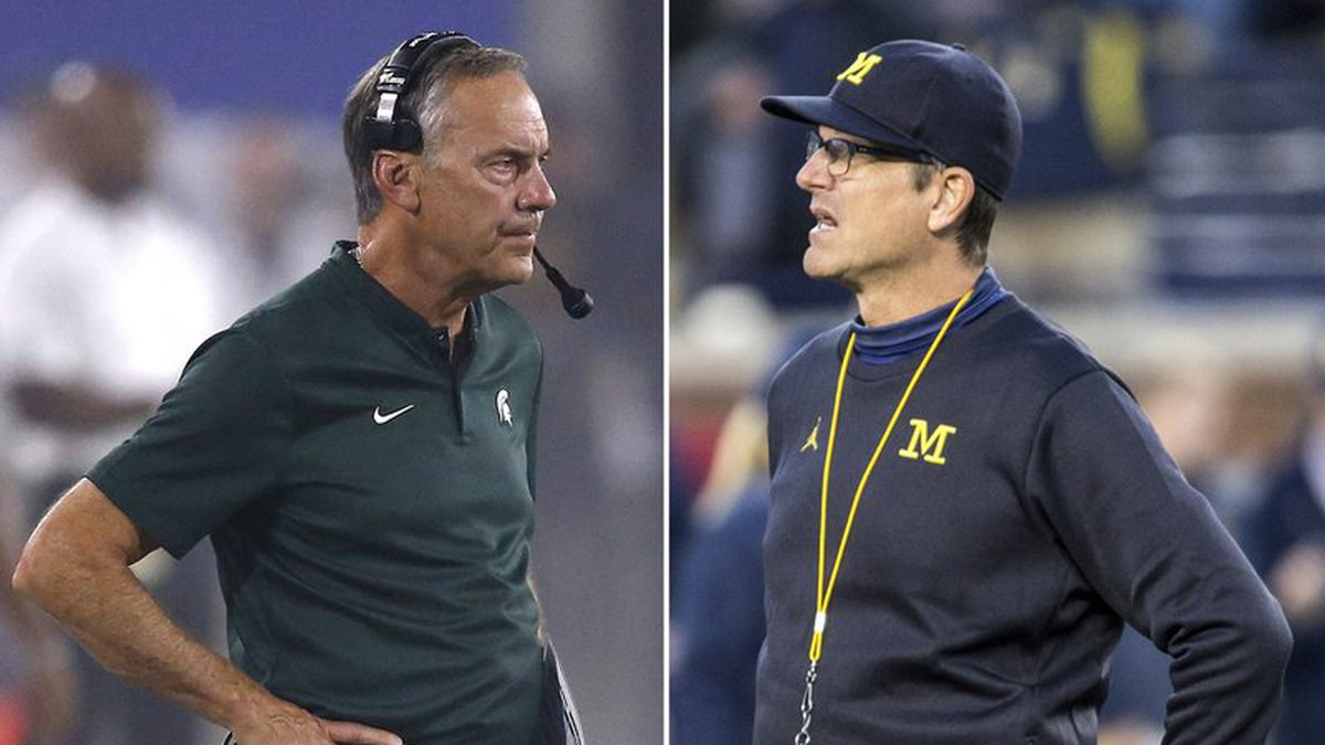 At left, in a Sept. 8, 2018, file photo, Michigan State head coach Mark Dantonio watches his...