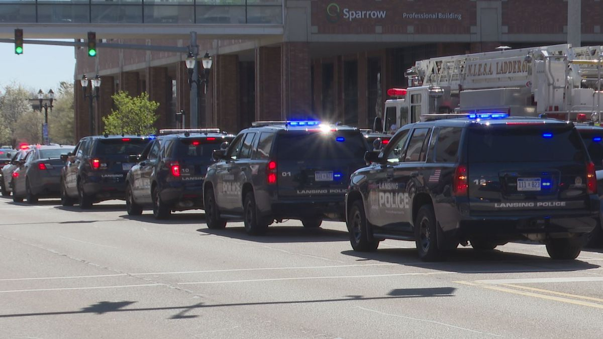 Detroit Police Officers made the journey to Lansing to show support for their fellow officer. (Source: WILX)