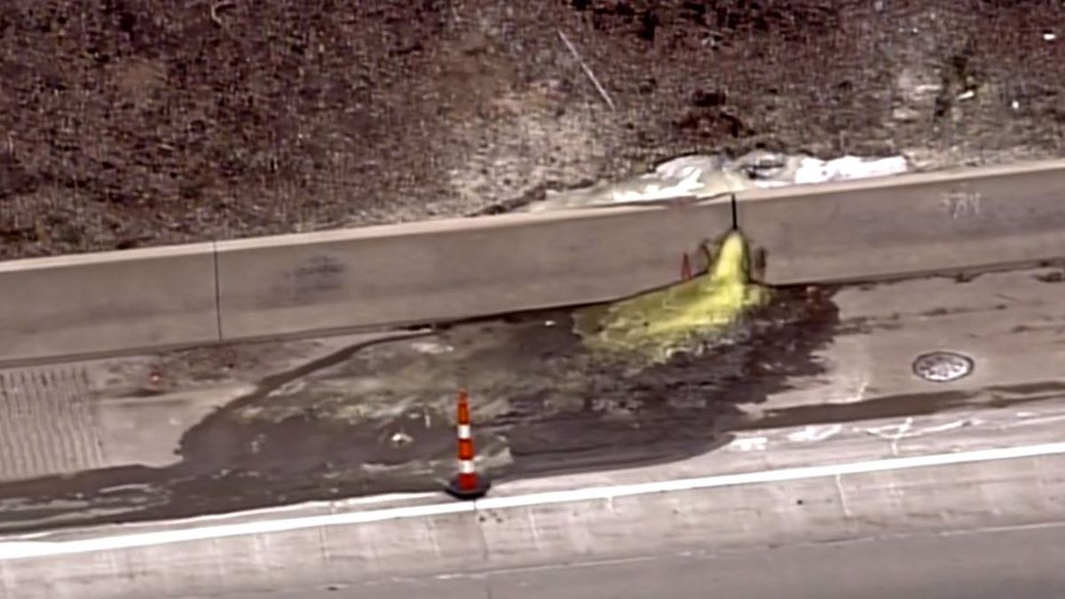 A clean-up on a Michigan highway after green slime oozes into lanes of traffic. (Source WILX)