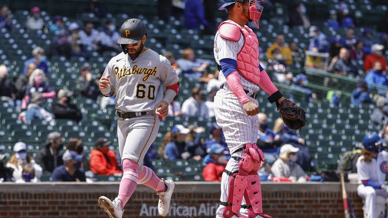 Pittsburgh Pirates' Ka'ai Tom (60) scores on a single hit by Wilmer Difo against the Chicago...